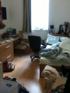 Excuse the mess - I had only just moved in. There's a bed under there somewhere.