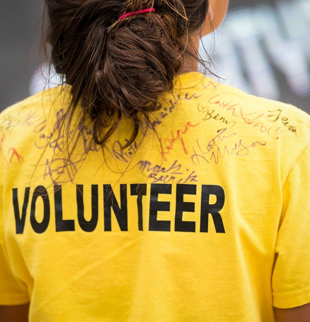 A Volunteer in a yellow t shirt